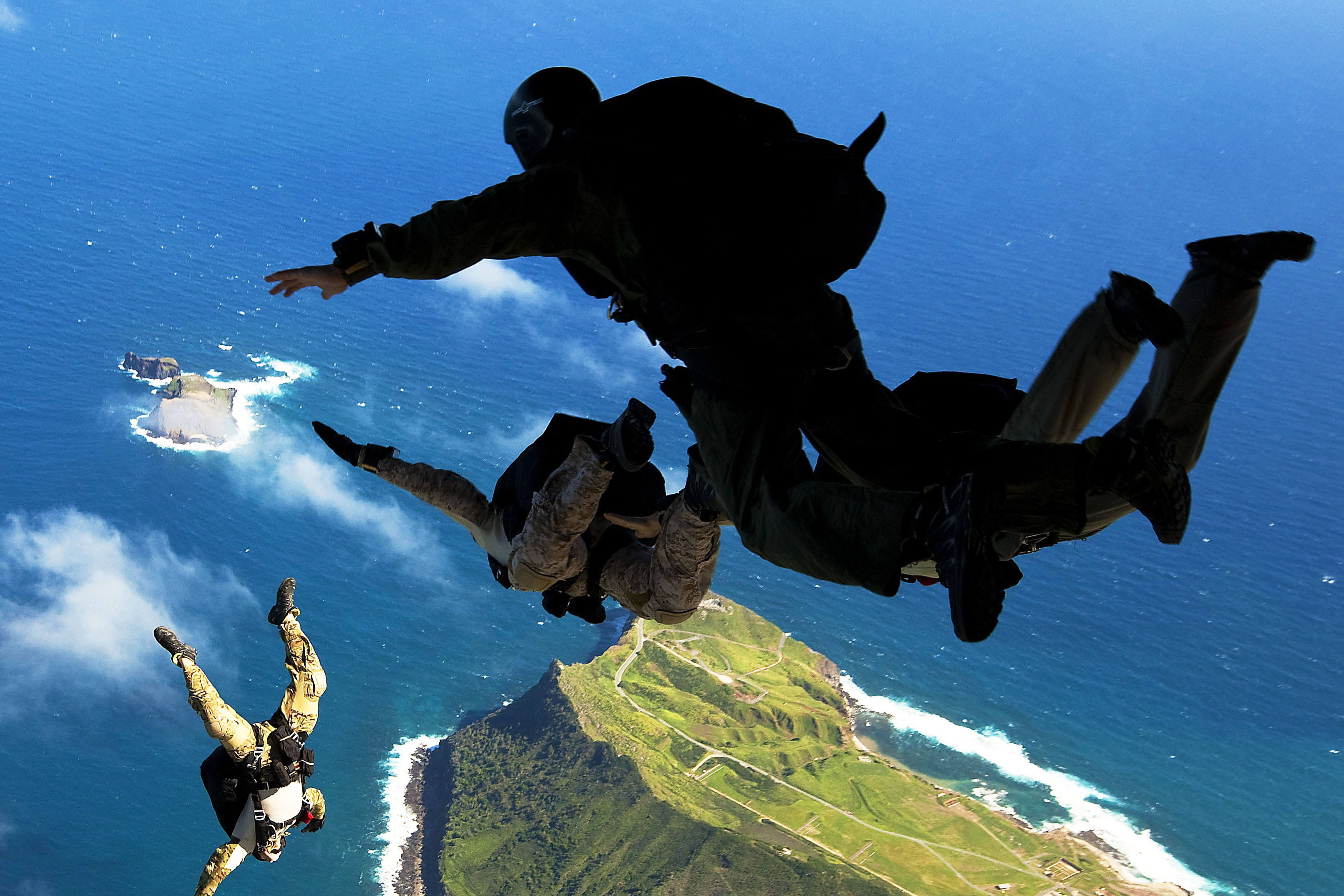 Army paratroopers jumping out of a plane
