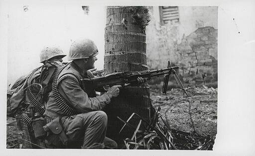 U.S. Marines scan the streets in Vietnam.