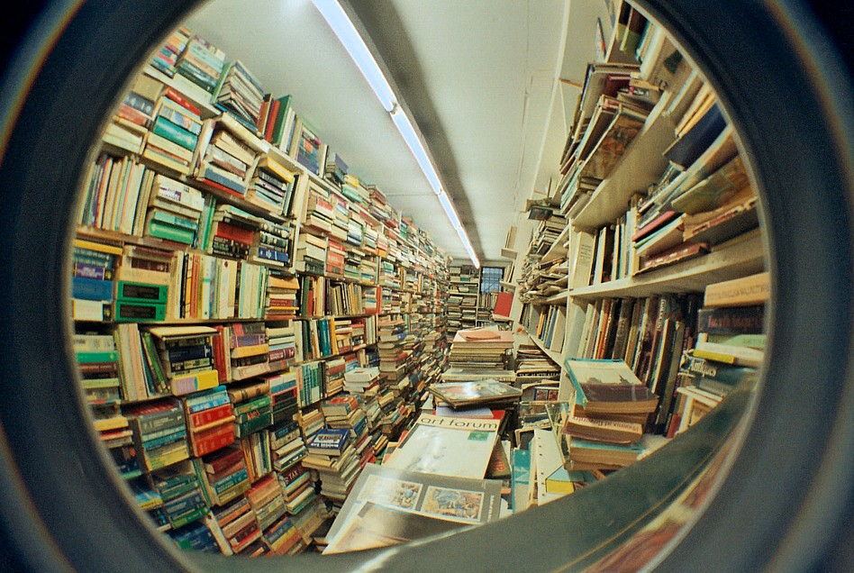 Hundreds of books seen through a keyhole