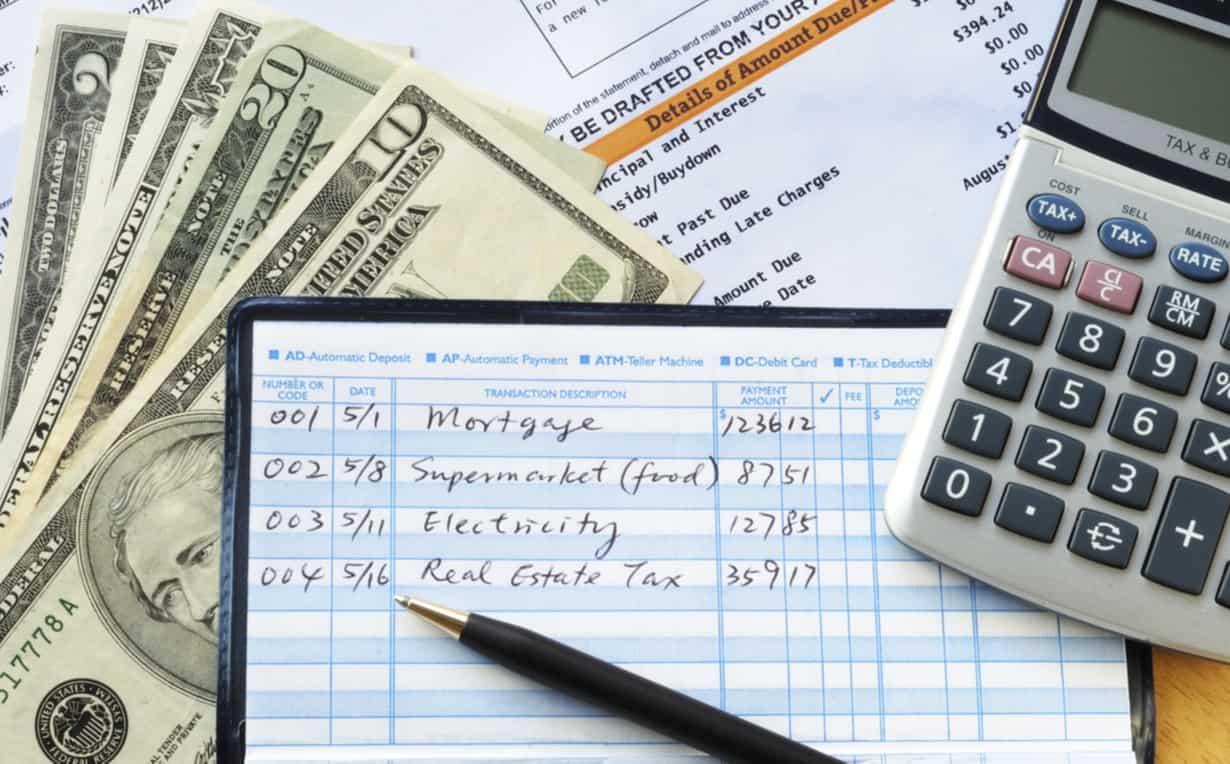 Checkbook, cash, calculator
